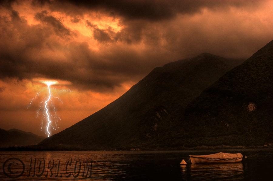 hdr photo lake lugano switzerland dark thunderstorm clouds boat mountains lightning background switzerland photography photo