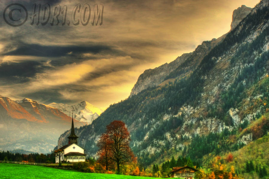 Beautiful sunset church Kandergrund Switzerland swiss alps background