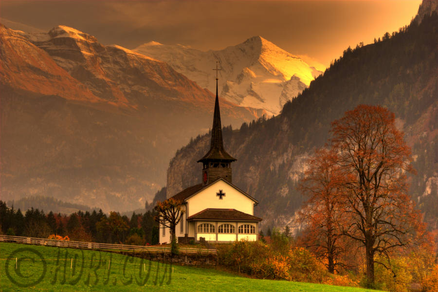 Beautiful sunset church Kandergrund Switzerland swiss alps